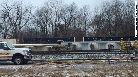 Firefighters work at the site of a 16-car Norfolk Southern freight train derailment that forced the evacuation of dozens of western New York homes after ethanol leaked from two tankers on March 2 in Ripley, N.Y. (Alice Waters/The Observer via AP)