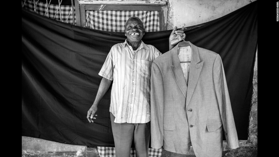 """A refugee at the age of seven, Sebastian arrived freezing in Zaire. """"It was cold, and my father gave me his jacket to keep me warm,"""" he remembers 60 years later. """"When I see that suit... I think about Angola. The day I can cross back into Angola, I will have it on me, and I will remember my father. I will wear it because I am now a father myself."""""""