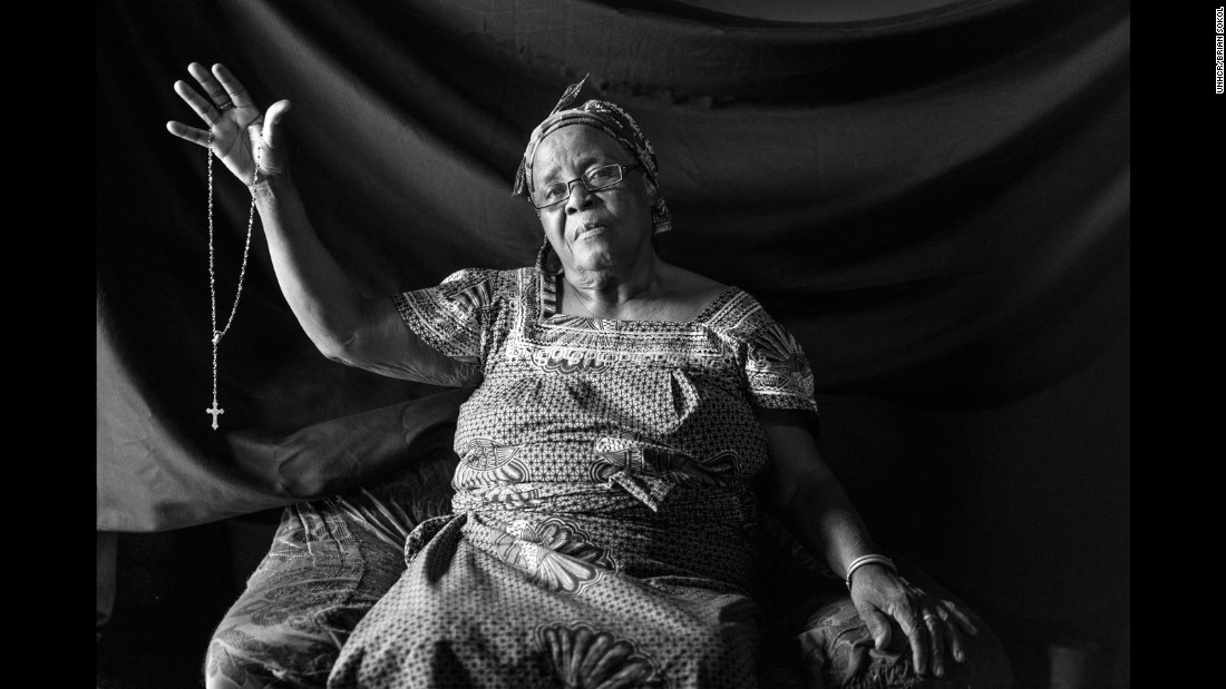 """Maria fled Angola in 1962 with her children, the youngest just nine days old at the time. Soldiers had killed her husband in front of her eyes, driving her to escape into the forest, where she lived for seven months, foraging and drinking rainwater. Looking back Maria, 68, says her cross saved her life and those of her children; """"with it I am at peace."""""""