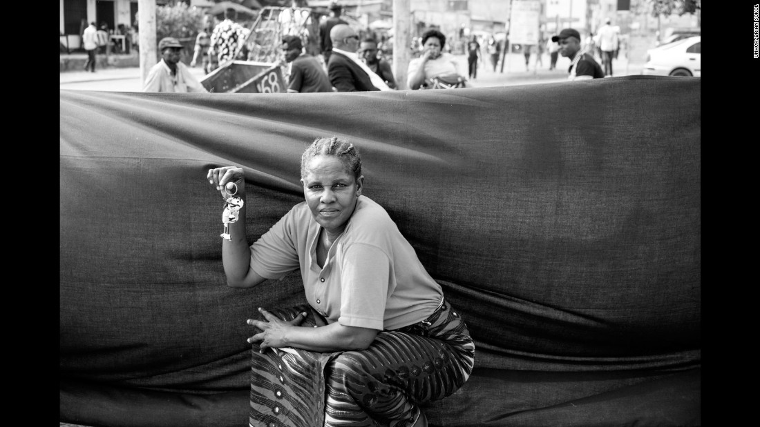 """Isabelle, 53, was born in Angola and twice displaced by war, as both a little girl and then a woman in 1992. The mother of six now lives in the DRC's capital and runs a roadside shop selling bread, dried fish and tea. If she were forced to flee again, Isabelle says she would take a key chain with a zebra toy attached. """"It would remind me of my small room in Kinshasa,"""" she says."""