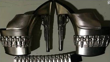 Revolver-themed shoes deemed a no-no in carry-on bag