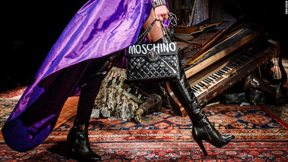 Moschino's Autumn-Winter 2016 collection began with a series of biker-chick chic looks featuring plenty of black leather and dramatic capes.