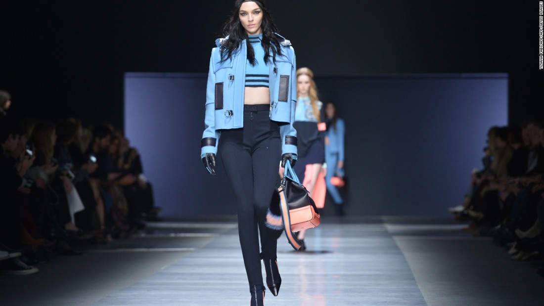 At fashion house Versace, designer Donatella Versace showcased bold patterns and bright colors.