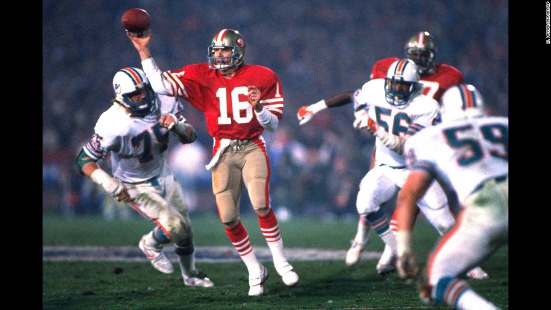 "<strong>Not your average Joe:</strong> San Francisco 49ers quarterback Joe Montana handles the ball under pressure in his team's Super Bowl win over Miami on January 20, 1985. Montana was named the game's most valuable player after setting several <a href=""http://www.washingtonpost.com/wp-srv/sports/nfl/longterm/superbowl/stories/sb19.htm"" target=""_blank"">records</a> in that game, including 331 yards passing. Montana and the 49ers won four Super Bowls from 1982-1990."