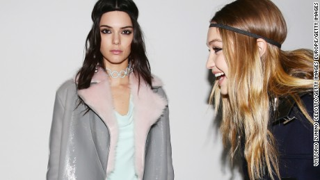 Kendall Jenner and Gigi Hadid pose backstage ahead of the Versace show during Milan Fashion Week