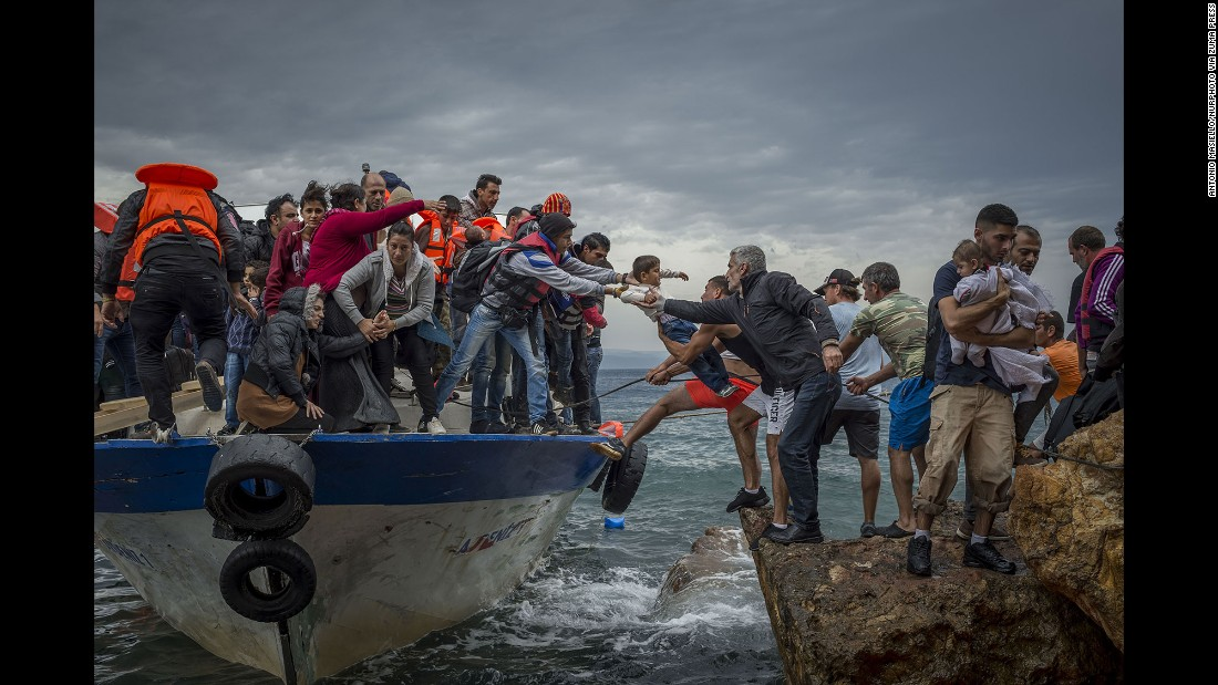Refugees and migrants get off a fishing boat at the Greek island of Lesbos after crossing the Aegean Sea from Turkey in October 2015. More than 1 million refugees and migrants escaped to Europe in 2015, the UN refugee agency said. 2016 has become the deadliest year for migrants crossing the Mediterranean bound for Europe.