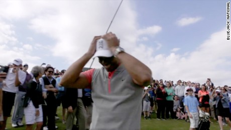 11-year-old's shot stuns Tiger Woods