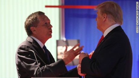NORTH CHARLESTON, SC - JANUARY 14:  Republican presidential candidates (L-R) Ohio Governor John Kasich and Donald Trump talk during a commercial break during the Fox Business Network Republican presidential debate at the North Charleston Coliseum and Performing Arts Center on January 14, 2016 in North Charleston, South Carolina. The sixth Republican debate is held in two parts, one main debate for the top seven candidates, and another for three other candidates lower in the current polls.  (Photo by Scott Olson/Getty Images)