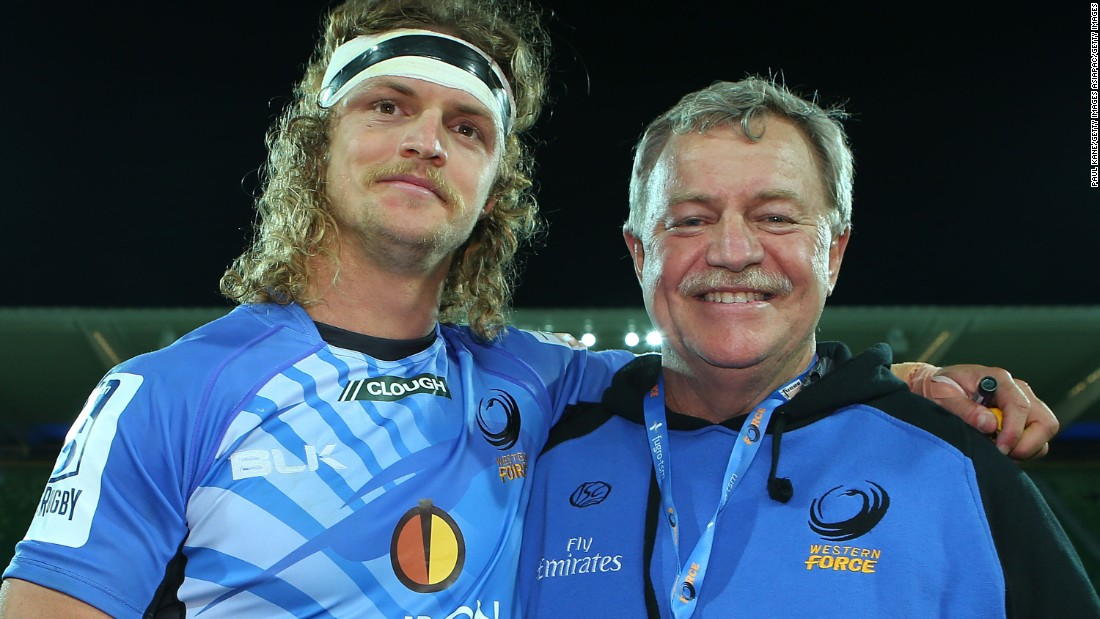 Nick Cummins' father Mark (right) has suffered with prostate cancer, while two of his siblings have the condition cystic fibrosis.
