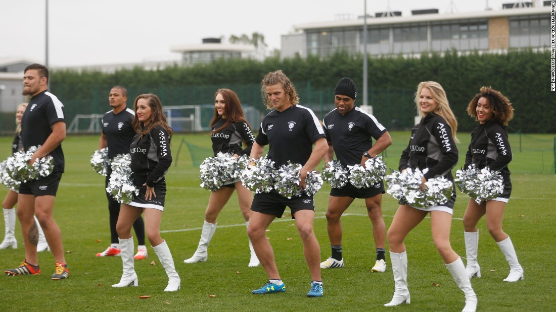 But the wing is as well known for his colorful antics -- here doing a spot of cheerleader -- as he is for his rugby.