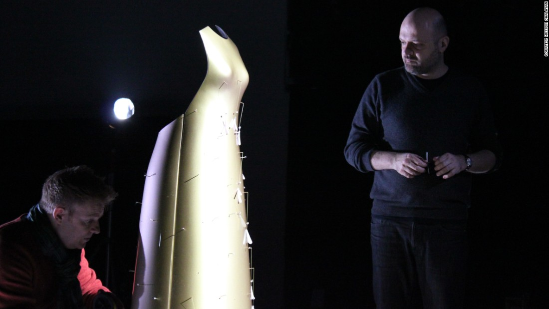 "Made of gold, this floating dress expels Swarovski crystal ""pollen"" as it moves."