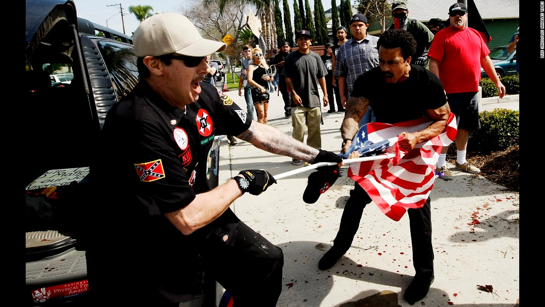 "A member of the Ku Klux Klan fights a man for an American flag during a KKK rally in Anaheim, California, on Saturday, February 27. <a href=""http://www.cnn.com/2016/02/27/us/kkk-rally-in-anaheim-violence/"" target=""_blank"">Violence broke out</a> between KKK members and counterprotesters, leaving five people injured and 13 people arrested, authorities said."