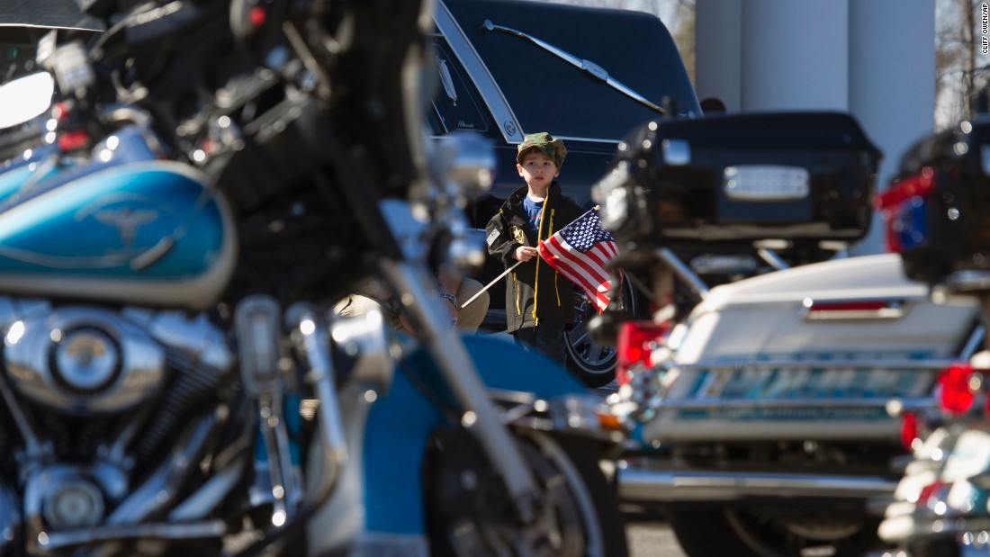 "A 4-year-old boy looks at police motorcycles in Woodbridge, Virginia, during a police officer's funeral on Tuesday, March 1. Ashley Guindon, 28, <a href=""http://www.cnn.com/2016/02/28/us/prince-william-county-officer-shooting/"" target=""_blank"">was fatally shot</a> during her first day on the job."
