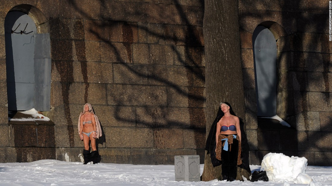 Women sunbathe at the Peter and Paul Fortress in St. Petersburg, Russia, on Tuesday, March 1.
