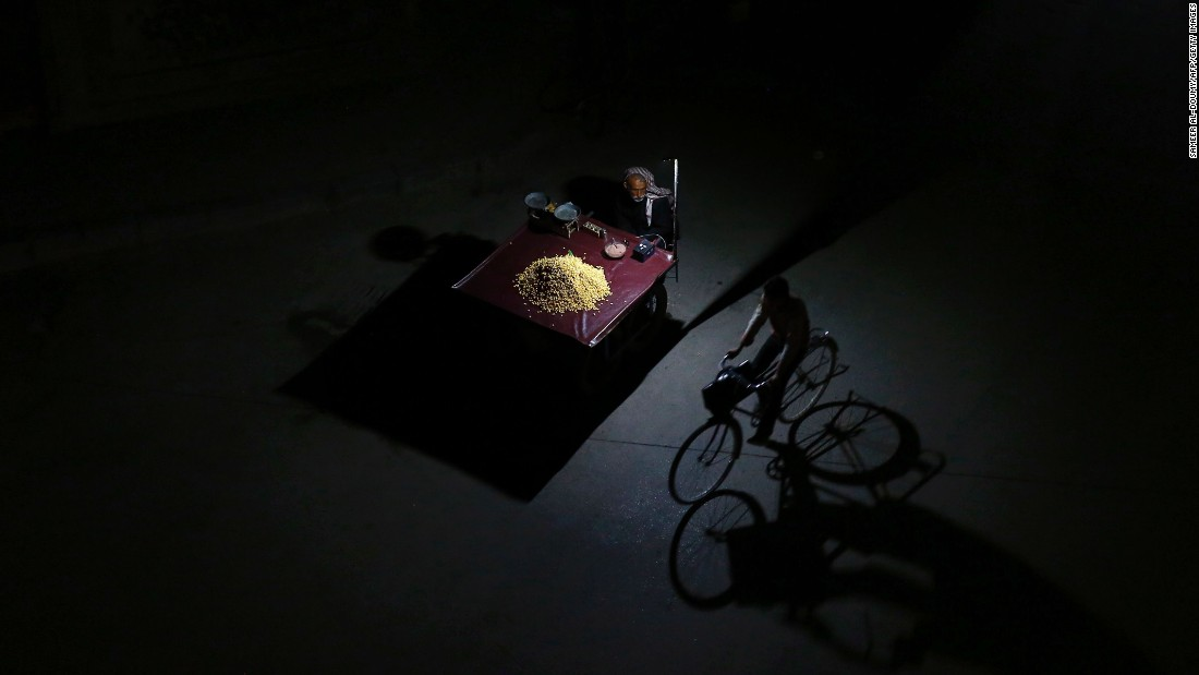 "A man rides his bicycle past a man selling grain in Douma, Syria, on Monday, February 29. A <a href=""http://www.cnn.com/2016/02/25/middleeast/syria-civil-war-q-and-a/index.html"" target=""_blank"">""cessation of hostilities""</a> began last week in the war-torn country, where more than 250,000 people have died in the past five years."