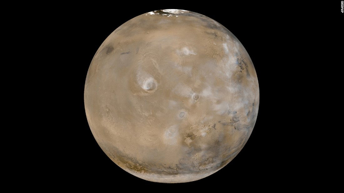 This view of Mars shows huge volcanoes in what's called the Tharsis Montes region. The photo is a composite of 24 images taken on February 14, 2003, by the Mars Global Surveyor, a NASA spacecraft orbiting the red planet. NASA says Tharsis Montes is the largest volcanic region on Mars. It's about 2,485 miles (4,000 kilometers) across and 6 miles (10 kilometers) high. It contains 12 large volcanoes, including Olympus Mons, the largest of the Tharsis volcanoes.