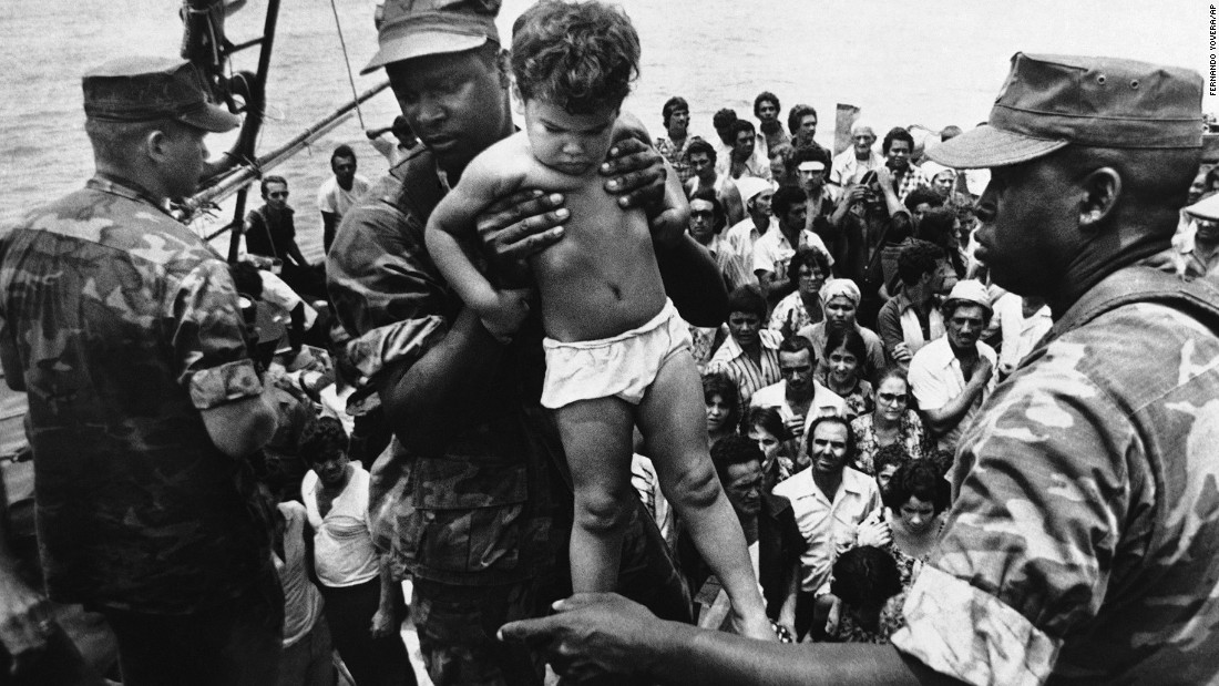 "<strong>Mass exodus from Cuba:</strong> Starting in April 1980, more than <a href=""http://www.politico.com/story/2009/04/castro-launches-mariel-boatlift-april-20-1980-021421"" target=""_blank"">125,000 Cubans</a> fled from the port of Mariel to Florida. Associated Press photographer Fernando Yovera captured this image of a U.S. Marine lifting a Cuban child off one of the boats that came into Key West on May 10, 1980. Of the 1,700 boats that made the journey from Cuba that year, many were overcrowded, and 27 migrants died before reaching the United States."