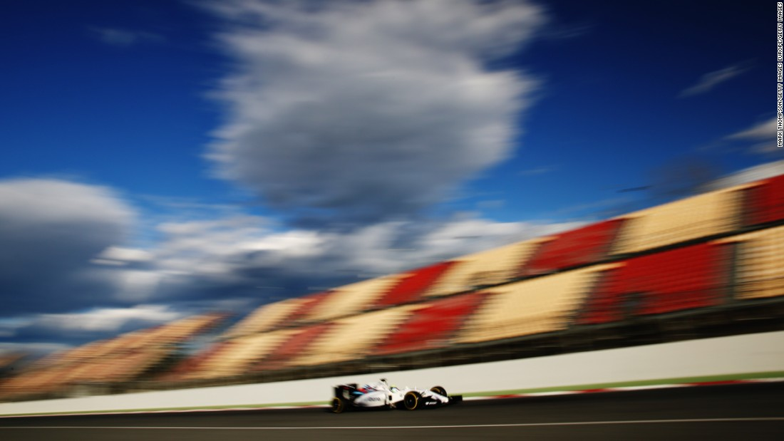 Felipe Massa of Williams speeds by the empty grandstand on day three of the second week of testing. The Brazilian finished second fastest on Thursday with a time of 1:23.192.