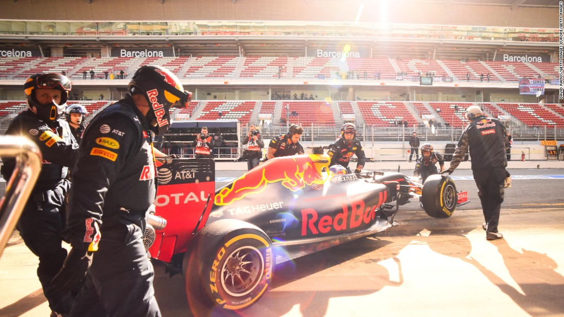 Daniel Ricciardo of Red Bull Racing is pushed back into the garage during day two of  testing.