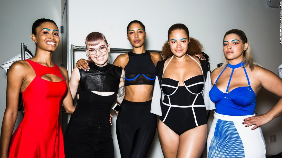 Models pose backstage at New York Fashion Week Spring-Summer 2016 wearing Chromat, thought to be one of the most diverse shows of the season. Although 77.6% of the time models walking down the runway were white, New York was the frontrunner for diverse models, then London, Paris and Milan.