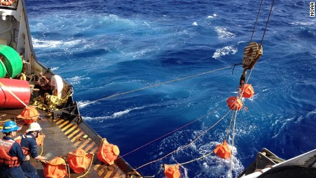 Hauling up hydrophone during the Challenger Deep mission in 2015. (