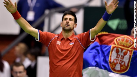 An exhausted Novak Djokovic reacts after beating Kazakhstan's Mikhail Kukushkin in a marathon five-set Davis Cup rubber in Belgrade.