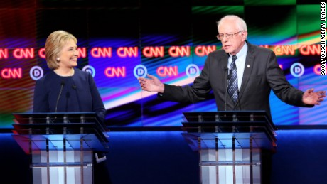 Democratic presidential candidate Senator Bernie Sanders (D-VT) and Democratic presidential candidate Hillary Clinton speak during the CNN Democratic Presidential Primary Debate at the Whiting Auditorium at the Cultural Center Campus on March 6, 2016 in Flint, Michigan.