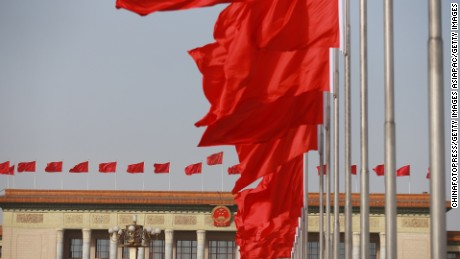 BEIJING, CHINA - MARCH 05: (CHINA OUT) Red flags fly high in front of the Great Hall of the People as the Fourth Session of the 12th National People's Congress (CPC) opens on March 5, 2016 in Beijing, China. China's Communist-controlled parliament opened its annual session on March 5 and is expected to approve a new five-year plan to tackle slowing growth in the world's second-largest economy.  (Photo by Zhang Jie/Hainan Daily/VCG VCG via Getty Images)