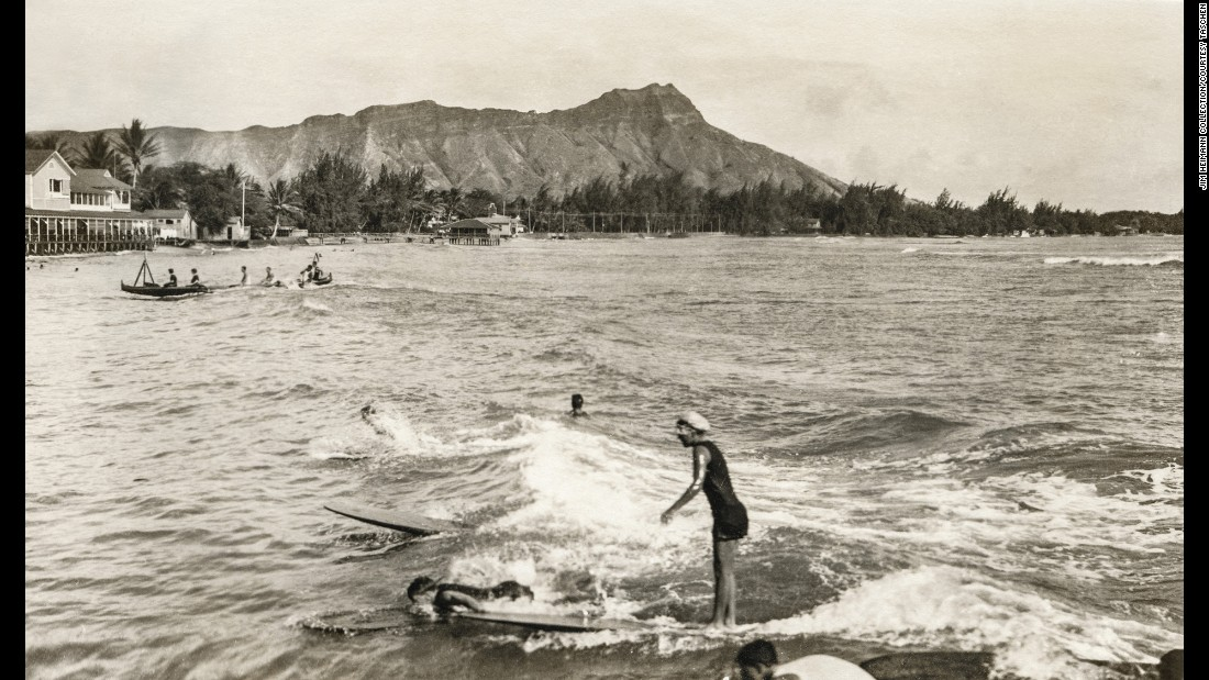 A surfer rides a wave at Waikiki Beach around 1914. Some of the sport's earliest forms trace back to ancient Polynesia in 2000 B.C.