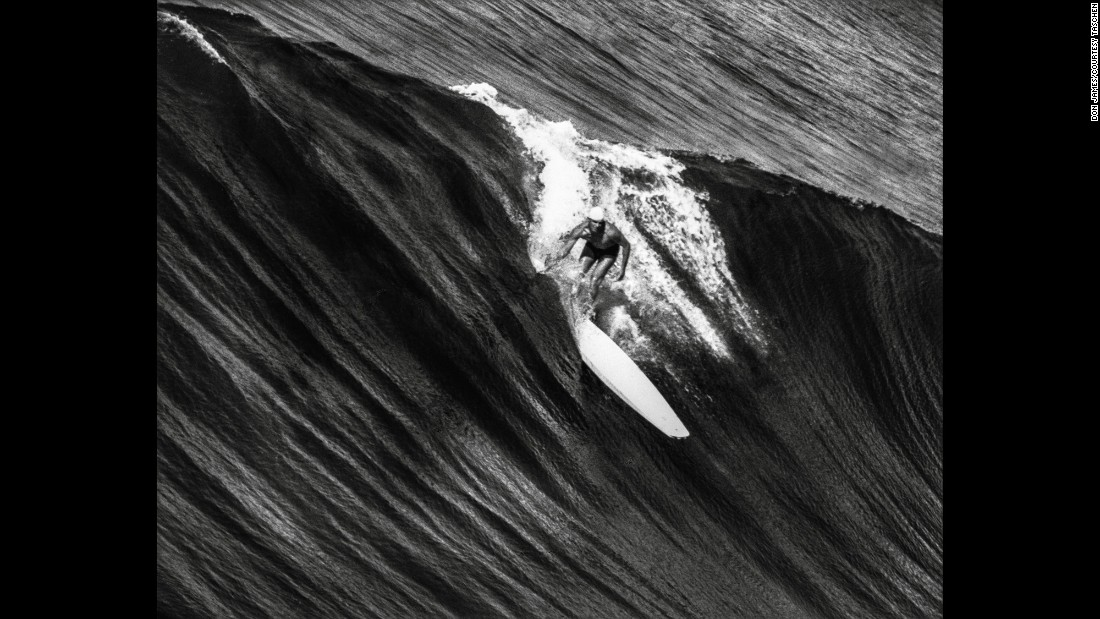 Jim Bailey rides a wave on California's Hermosa Beach circa 1936. Bailey was an outstanding Los Angeles County lifeguard and one of South Bay's best surfers. He was renowned for tandem surfing and taking his dog, Rusty, out for a ride.