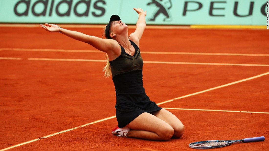 Sharapova falls to her knees after winning the 2012 French Open to complete the career Grand Slam. She also won the French Open in 2014.