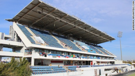 The hockey stadium at Athens' old Olympic park is being used to house refugees.