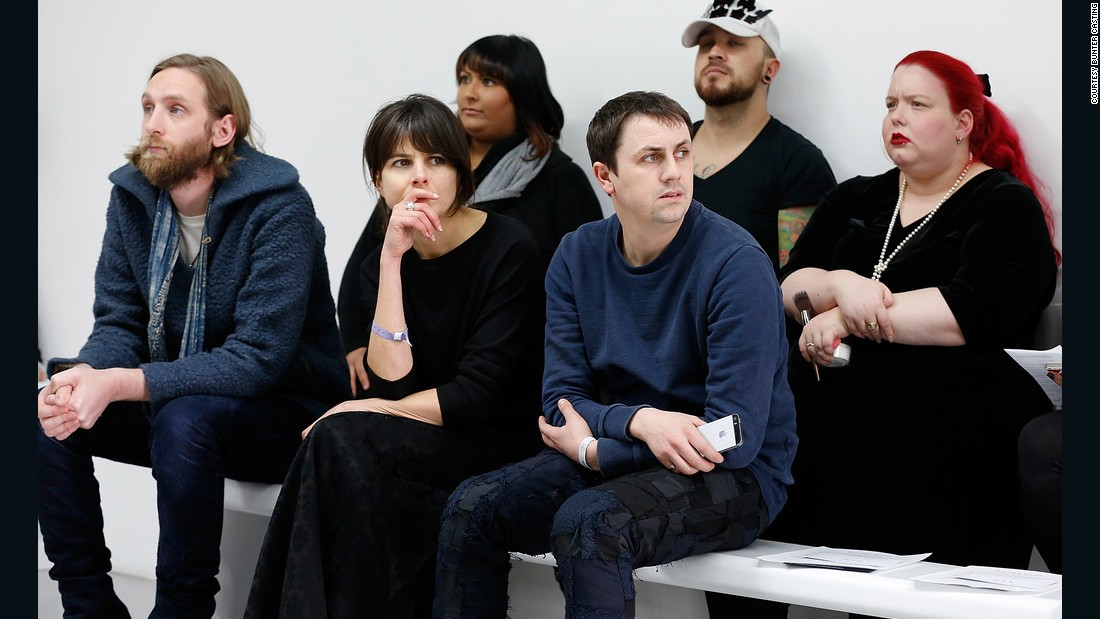 Casting director Sarah Bunter sitting with fashion designer Matthew Miller at London Fashion Week.