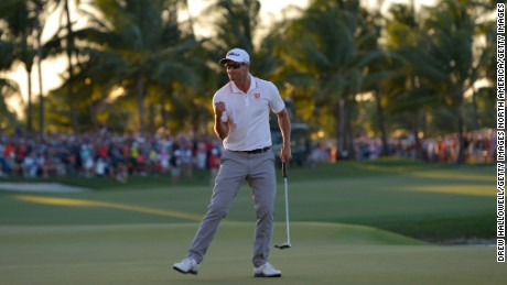 Scott celebrates after sinking the final and decisive putt to clinch the WGC-Cadillac Championship