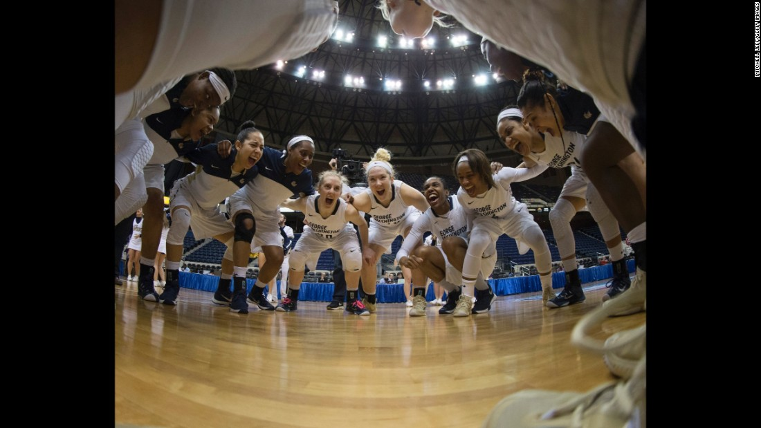Basketball players from George Washington University huddle before an Atlantic 10 tournament game on Friday, March 4. The team won the tournament for the second straight season.
