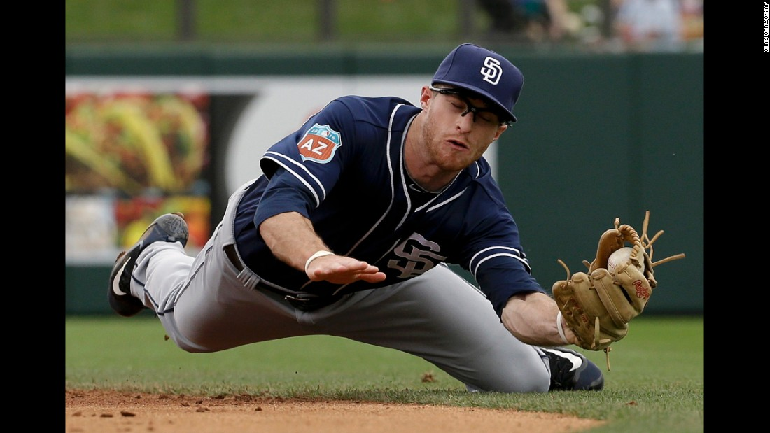 San Diego's Cory Spangenberg fields a ball during a spring-training game in Scottsdale, Arizona, on Saturday, March 5.