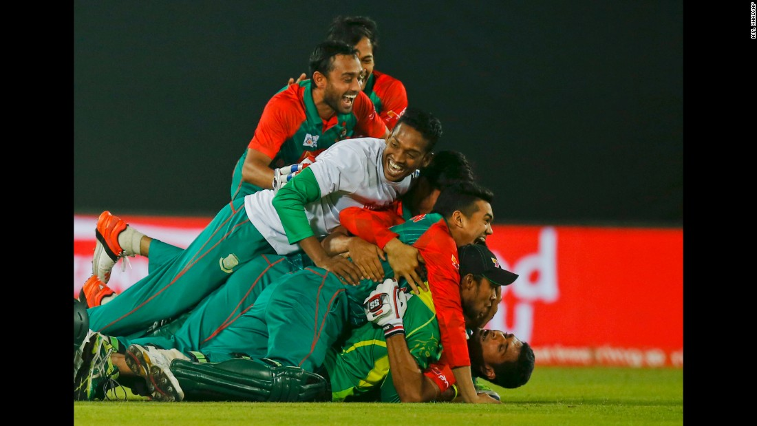 Bangladesh's cricket team celebrates after defeating Pakistan in the Asia Cup on Wednesday, March 2.