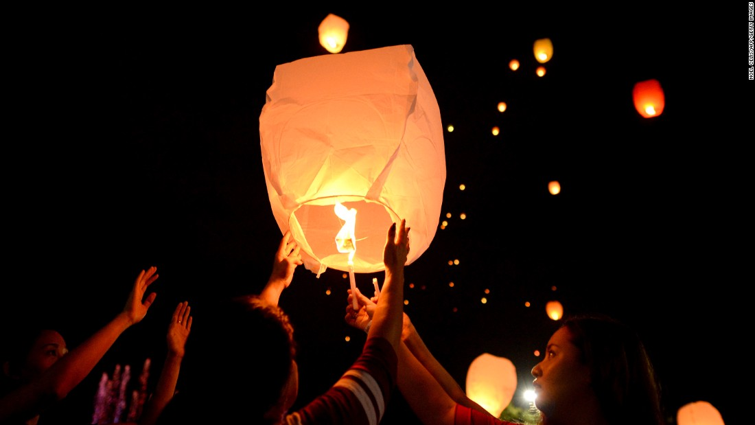 People in Manila release lanterns on Monday, March 7.
