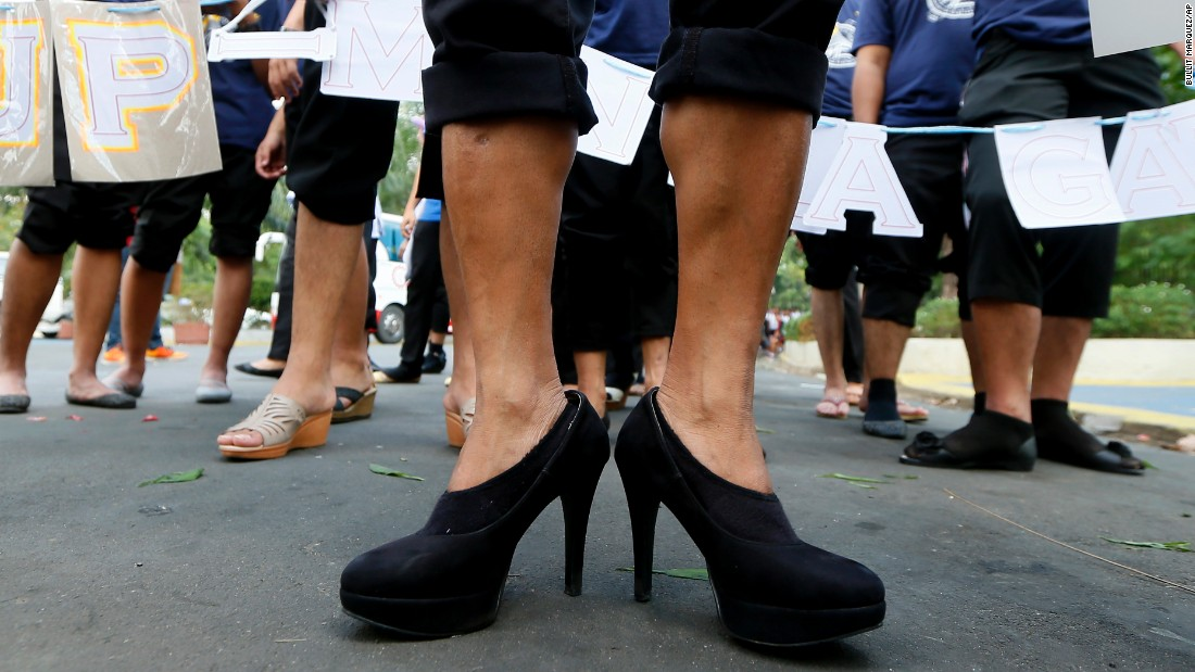 Male students wearing high-heeled shoes prepare to march around a park in Quezon City, Philippines, to pay tribute to women all over the world on March 7.