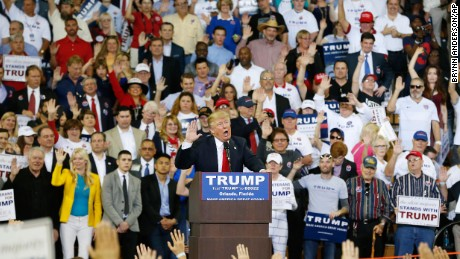 Republican presidential candidate Donald Trump speaks to the crowd asking them to take a pledge to promise to vote for him during a campaign rally, Saturday, March 5, 2016, in Orlando, Fla. (AP Photo/Brynn Anderson)