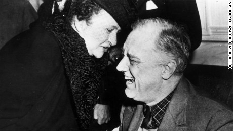 December 1943:  Secretary of Labour Frances Perkins (1880 - 1965) greets President Franklin Delano Roosevelt (1882 - 1945) upon his return from the Tehran Conference.  (Photo by MPI/Getty Images)