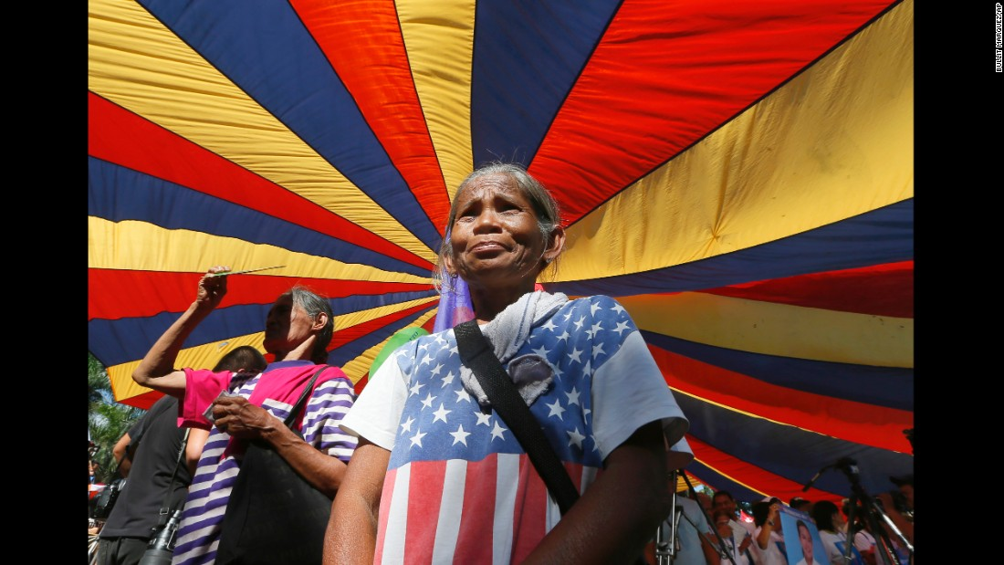 A protester wears an improvised American flag as she joins a rally in Manila, Philippines, on March 8.