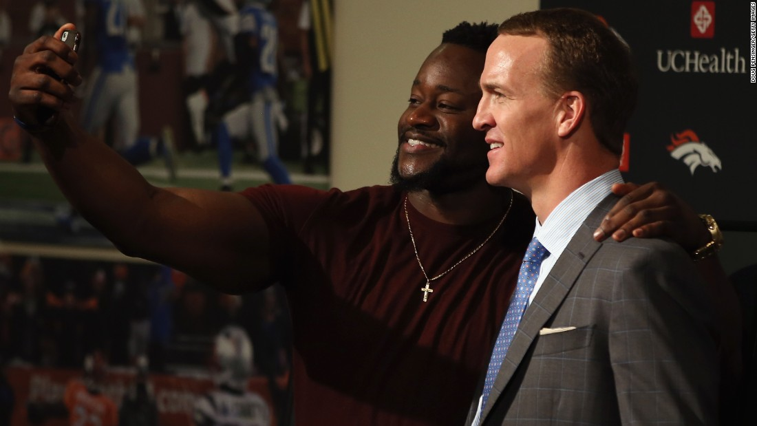 "Denver Broncos defensive end Kenny Anunike takes a photo with former teammate Peyton Manning after Manning <a href=""http://www.cnn.com/2016/03/07/sport/denver-broncos-peyton-manning-to-retire/"" target=""_blank"">announced his retirement</a> on Monday, March 7. <a href=""http://www.cnn.com/2016/02/08/us/gallery/peyton-manning/index.html"" target=""_blank"">See photos from Manning's historic career</a>"