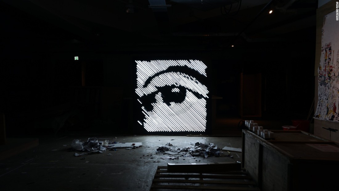 "A work in progress, titled 'Glimpse,' in Vhils' studio in the Hong Kong industrial neighborhood of Aberdeen. The Debris exhibition marks his first experiments with neon lights, a material he has associated with the city since watching Wong Kar-wai films as a teenager. ""Those who see it everyday don't recognize it's such a beautiful [medium] and taken to such an extreme in Hong Kong,"" says Farto.<br />"