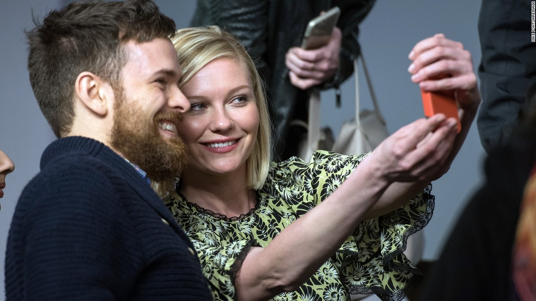 "Actress Kirsten Dunst takes a selfie in New York at a promotional event for the movie ""Midnight Special"" on Monday, March 7."