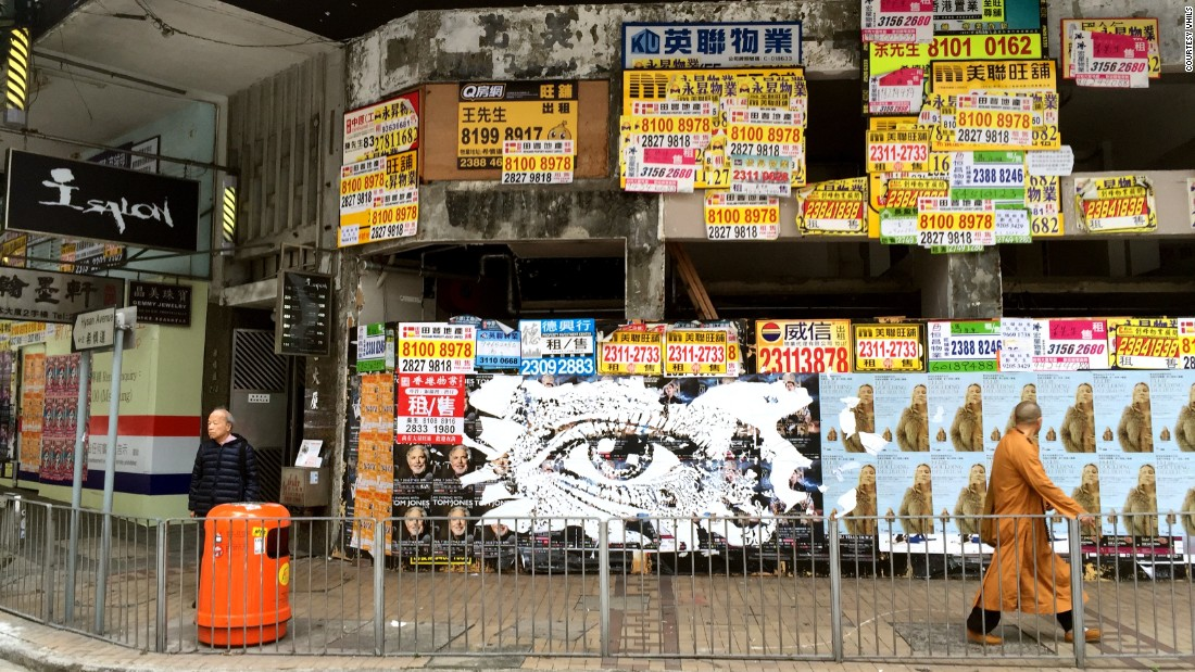 Vhils carved this striking image into a billboard on Hysan Avenue in Causeway Bay, a crowded Hong Kong commercial district, last year. The wall was quickly covered over by a fresh layer of advertisements, reflecting the fast pace of the city.