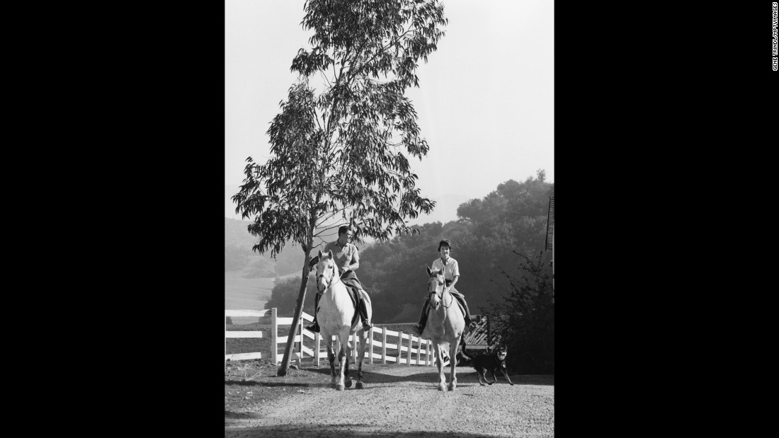 The couple rides horses in Agoura in 1966.