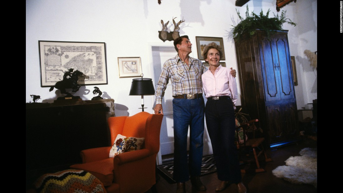 "Ronald and Nancy at their ranch in 1980. He became President in January 1981. ""Our former first lady redefined the role in her time here,"" President Barack Obama said after Nancy's death. ""Later, in her long goodbye with President Reagan, she became a voice on behalf of millions of families going through the depleting, aching reality of Alzheimer's, and took on a new role, as advocate, on behalf of treatments that hold the potential and the promise to improve and save lives."""