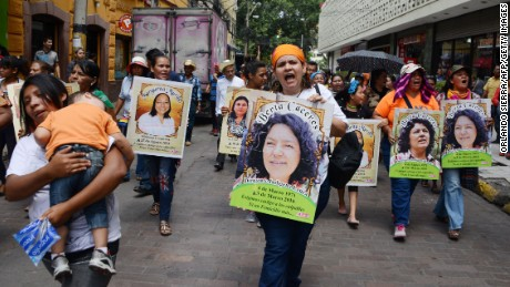 Protesters carried posters showing slain Honduran environmentalist Berta Cáceres at a demonstration in the country's capital. Activists have accused authorities of not doing enough to protect her.
