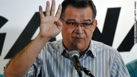 Venezuelan Enrique Marquez, who was elected as new deputy to the National Assembly, speaks during a press conference in Caracas on December 7, 2015. Venezuela's jubilant opposition vowed Monday to drag the oil-rich country out of its economic crisis and free political prisoners after winning control of congress from socialist President Nicolas Maduro. AFP PHOTO/JUAN BARRETO / AFP / JUAN BARRETO        (Photo credit should read JUAN BARRETO/AFP/Getty Images)